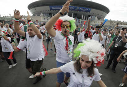 Iranian fans dance in front of Saint Petersburg stadium prior the group B match between Morocco and Iran at the 2018 soccer World Cup in St. Petersburg, Russia, June 15, 2018.