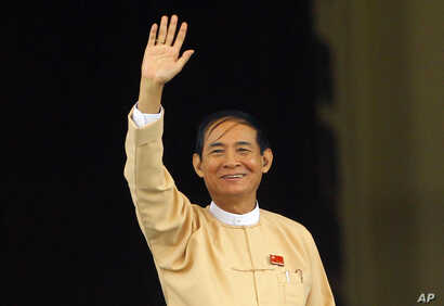 Win Myint, newly elected president of Myanmar, waves to media outside the parliament in Naypyitaw, Myanmar, in Naypyitaw, Myanmar, Wednesday, March 28, 2018.