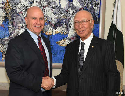 In this handout photograph released by the Press Information Department (PID) on April 17, 2017, Pakistan's National Security Advisor Sartaj Aziz (R) shakes hands with US National Security Advisor Lieutenant-General H.R. McMaster at the Foreign Minis...