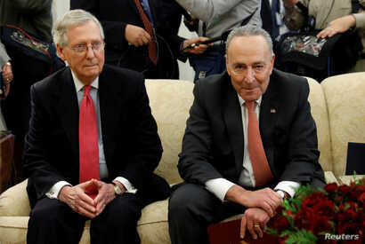 Senate Majority Leader Mitch McConnell and Senate Minority Leader Chuck Schumer take part in a meeting with U.S. President Donald Trump and other Congressional leaders in the Oval Office of the White House in Washington, U.S., Dec. 7, 2017.