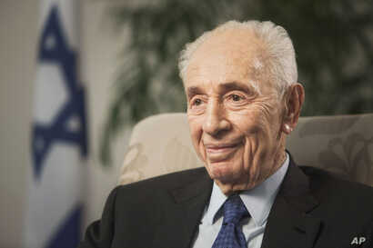 FILE - Former Israeli President Shimon Peres speaks during an interview with The Associated Press in Jerusalem, Nov. 2, 2015.