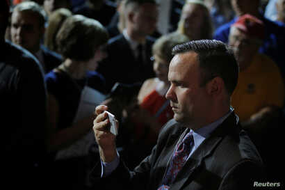 FILE - Dan Scavino, director of social media and senior adviser to then-Republican presidential candidate Donald Trump, records Trump greeting audience members at a campaign rally in Bangor, Maine, June 29, 2016.
