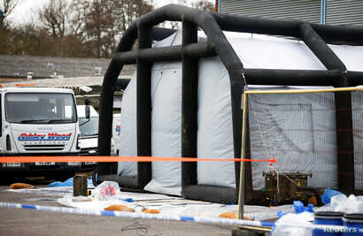 Police tape and bagged items are seen near an inflatable structure in the courtyard of Ashley Wood Recovery; where emergency services worked following the poisoning of former Russian intelligence officer Sergei Skripal and his daughter Yulia; in Sali...