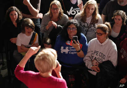 The crowd listens as Sen. Elizabeth Warren, D-Mass, speaks during an organizing event at Curate event space in Des Moines, Iowa, Jan. 5, 2019.