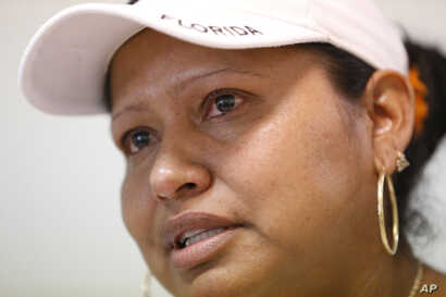 Tears well up in the eyes of Marina, 34, of Mexico, as she speaks during an interview with The Associated Press in Homestead, Fla., Feb. 13, 2017. A county with an immigrant leader where most people were born abroad has bucked the trend of the sanctu...