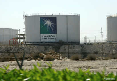 FILE - Oil tanks seen at the Saudi Aramco headquarters during a media tour at Damam city, Nov. 11, 2007.