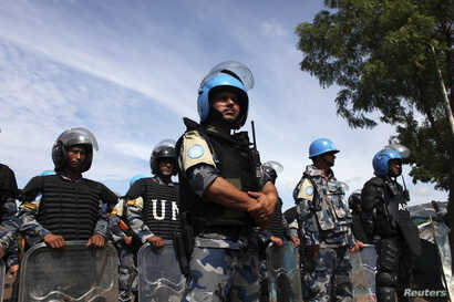 FILE - U.N. peacekeepers are seen at an IDP (internally displaced persons) camp in the United Nations Mission In South Sudan (UNMISS) base in Juba May 6, 2014.