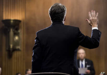 Supreme Court nominee Judge Brett Kavanaugh is sworn in by Chairman Chuck Grassley, R-Iowa, before testifying during the Senate Judiciary Committee, Sept. 27, 2018 on Capitol Hill in Washington.