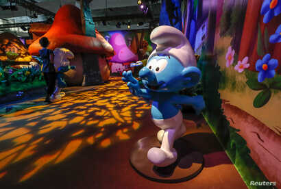 Smurf characters are seen at the Smurf Experience exhibition, depicting a larger-than-life recreation of the Smurf village, marking the 60th anniversary of the creation of the Smurfs by cartoonist Peyo, in Brussels, Belgium, June 12, 2018.