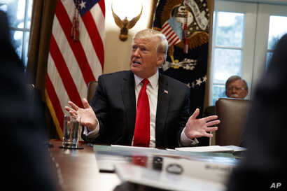 President Donald Trump speaks during a Cabinet meeting at the White House, Jan. 2, 2019, in Washington.