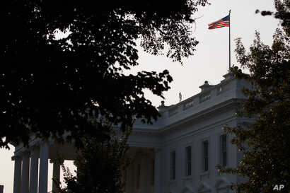 An American flag above the White House flies at full-staff less than 48 hours after the death of Sen. John McCain, Aug. 27, 2018, in Washington.