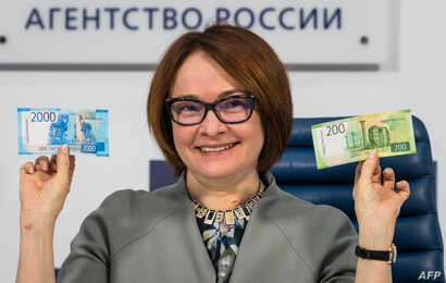 Russia's Central bank chief Elvira Nabiullina presents the new 2,000 and 200 ruble banknotes in Moscow on Oct. 12, 2017.