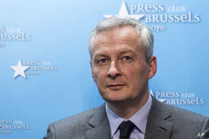 FILE - France's Finance and Economy Minister Bruno Le Maire speaks during a media conference regarding steel tariffs in Brussels, March 12, 2018.