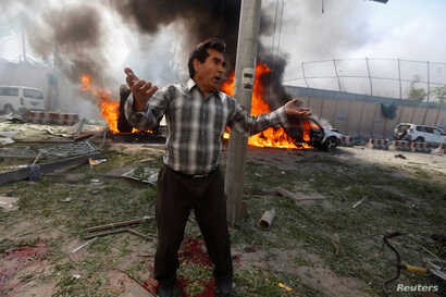 An Afghan man reacts at the site of a blast in Kabul, Afghanistan, May 31, 2017.