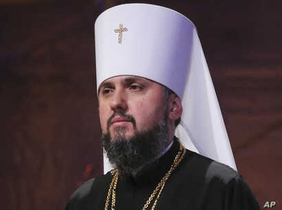 A new head of an independent Ukrainian church, Metropolitan of Kyiv Epiphanius, greets people gathered to support a new, independent Ukrainian church near the St. Sophia Cathedral in Kyiv, Ukraine, Dec. 15, 2018.