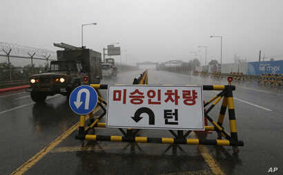 A South Korean military vehicle crosses Unification Bridge, which leads to the demilitarized zone, near the border village of Panmunjom in Paju, South Korea, May 16, 2018.