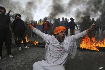 A protestor shouts slogans against Thursday's attack on a paramilitary convoy, in Jammu, India, Friday, Feb.15, 2019.
