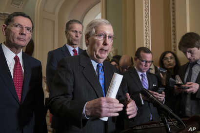 Senate Majority Leader Mitch McConnell, R-Ky., center, speaks to reporters about the possibility of a partial government shutdown, at the Capitol in Washington, Dec. 18, 2018.