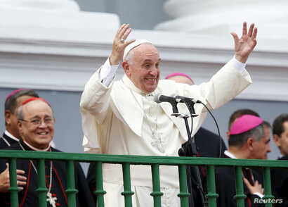 Pope Francis gestures while addressing the crowd from the Cathedral of Our Lady of the Assumption in Santiago, Cuba, Sept. 22, 2015.