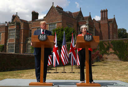 Britain's Prime Minister Theresa May and U.S. President Donald Trump hold a joint news conference at Chequers, the official country residence of the Prime Minister, near Aylesbury, Britain