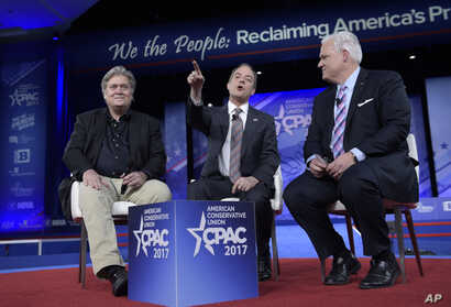 White House Chief of Staff Reince Priebus, center, with White House strategist Stephen Bannon, left, and American Conservative Chairman Matt Schlapp, speaks during the Conservative Political Action Conference in National Harbor, Md., Feb. 23, 2017.