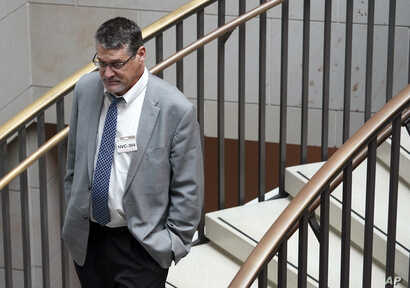 FILE - Glenn Simpson, founder of the research firm Fusion GPS, arrives for a scheduled appearance before a closed House Intelligence Committee hearing on Capitol Hill in Washington, Nov. 14, 2017.