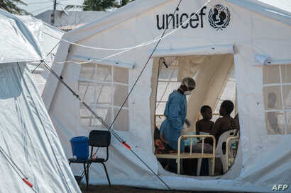 Patients are accommodated in a treatment tent at Macurungo urban health center in Beira, Mozambique, March 27, 2019. Five cases of cholera were confirmed in Mozambique Wednesday, but that has grown to nearly 140 by Thursday.