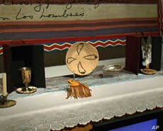 Among the objects on the altar in 'Temple for Pablo Tac' are a chalice, a medicine pouch, and eagle feathers.