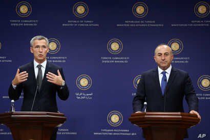 New NATO Secretary General Jens Stoltenberg, left, speaks to the media after talks with Turkey's Foreign Minister Mevlut Cavusoglu, right, in Ankara, Turkey, Oct. 9, 2014.
