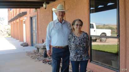 Jim and Sue Chilton on their porch in Arivaca, Arizona, July 21, 2016. (G. Flakus/VOA)
