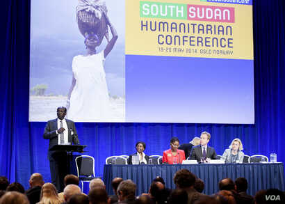 The delegate for the Organization for Economic Cooperation and Development at the pledging conference for South Sudan in Oslo addresses South Sudanese Foreign Minister Barnaba Marial Benjamin.