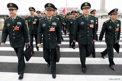 Military delegates arrive at the Great Hall of the People for a meeting ahead of China's annual session of parliament, in Beijing, March 4, 2018.