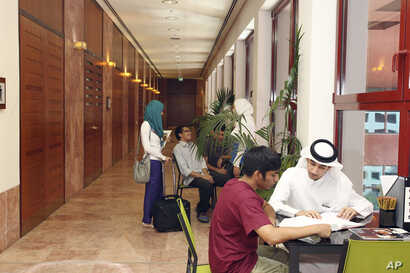 FILE - In this 2011 photo, students of different nationalities study at the Texas A&M University campus at Education City in Doha, Qatar.