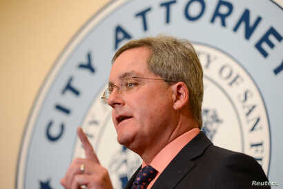 San Francisco City Attorney Dennis Herrera announces he has filed a lawsuit against President Donald Trump for his executive order targeting sanctuary cities, Jan. 31, 2017.