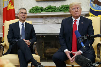 President Donald Trump meets with NATO Secretary General Jens Stoltenberg in the Oval Office of the White House, May 17, 2018, in Washington.