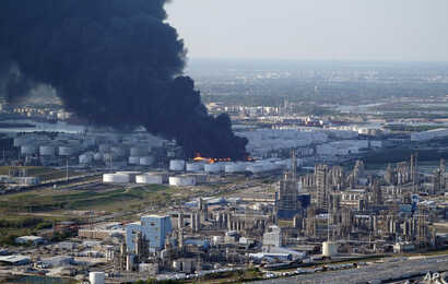 FILE - A plume of smoke rises from a petrochemical fire at the Intercontinental Terminals Company in Deer Park, Texas, March 18, 2019.