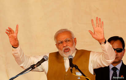 India's Prime Minister Narendra Modi addresses his supporters during a campaign meeting ahead of Gujarat state assembly election in Kalol on the outskirts of Ahmedabad, India, Dec. 8, 2017.