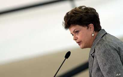 Brazil's President Dilma Rousseff delivers a speech at the Planalto palace in Brasilia, Aug. 8, 2011
