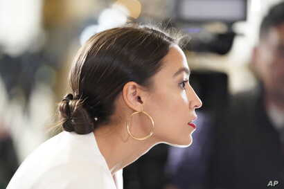 Rep. Alexandria Ocasio-Cortez, D-N.Y., arrives to hear President Donald Trump deliver his State of the Union address on Capitol Hill in Washington, Feb. 5, 2019.