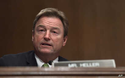 FILE - Sen. Dean Heller, a Nevada Republican, asks a question during a committee hearing on Capitol Hill in Washington, Jan. 30, 2018.