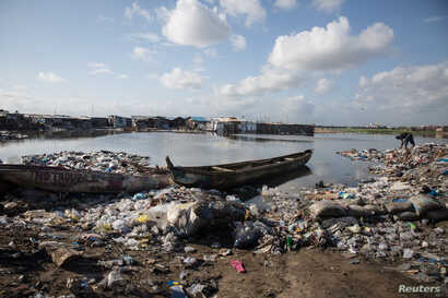 Rubbish piles up at the shoreline in West Point township, Monrovia, Liberia, May 30, 2018.