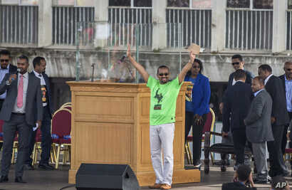 Ethiopia's Prime Minister Abiy Ahmed waves to the crowd at a large rally in his support, in Meskel Square in the capital, Addis Ababa, Ethiopia, June 23, 2018.