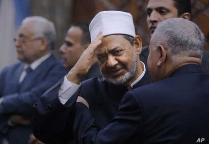 Sheikh Ahmed el-Tayeb, Grand Imam of Al-Azhar, the pre-eminent institute of Islamic learning in the Sunni Muslim world, greets participants of the second round of meetings between the Muslim Council of Elders and the World Council of Churches at Al A...