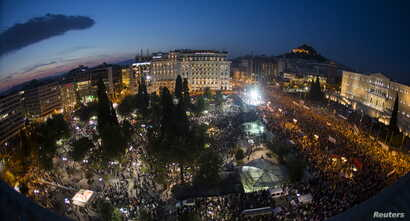 Protesters attend an anti-austerity rally in front of the parliament building in Athens, Greece, June 29, 2015.