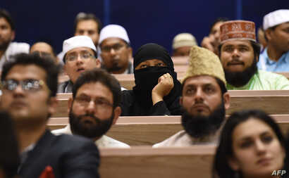 Delegates listen to Indian Prime Minister Narendra Modi's speech at the World Sufi Forum in New Delhi, March 17, 2016. The four-day event will be attended by more than 200 Indian and International delegates, spiritual leaders, scholars, academicians ...