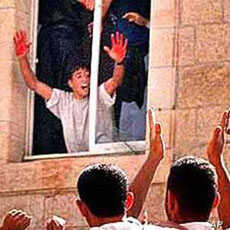 In a much circulated image, Abed al Aziz Salaha shows a cheering crowd his hands covered with blood of two killed Israelis (file photo).