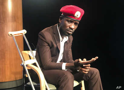 FILE - Ugandan pop star-turned-lawmaker Bobi Wine attends the National Press Club in Washington, Sept. 6, 2018.
