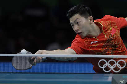 Ma Long of China plays against Quadri Aruna of Nigeria.during their Men's team table tennis first round match at the 2016 Summer Olympics in Rio de Janeiro, Brazil, Friday, Aug. 12, 2016.
