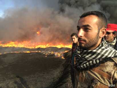 Mohammed says there is a company working to put out one fire, but progress is slow and other fires are not being attended to in Qayyarah, Iraq, Nov. 5,  2016.