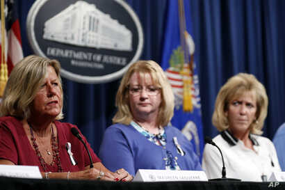 After meeting with Attorney General Jeff Sessions, Maureen Laquerre, left, Maureen Maloney and Mary Ann Mendoza, tell their stories to the media about their family members killed by people living in the United States without legal permission, at the ...